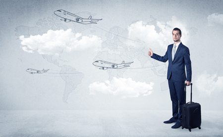 Businessman hitchhiking with airplanes around Foto de archivo
