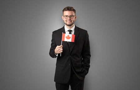 Handsome student standing with national flag