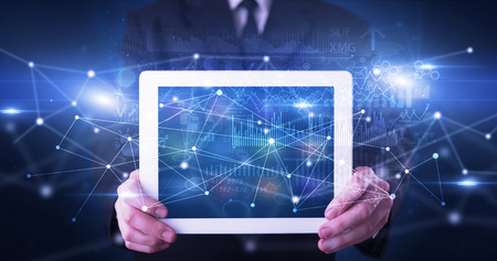 Hand holding tablet with virtual database concept