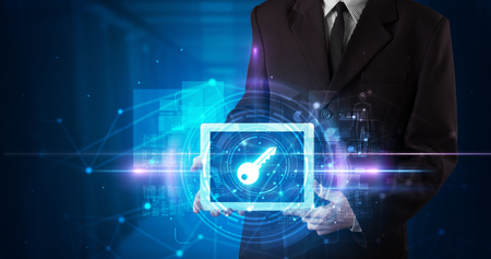 Hand holding tablet with online security concept