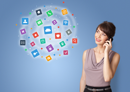 Person presenting new application icons and symbols 写真素材