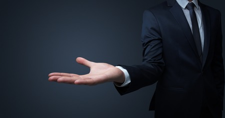 Businessman without head holding something without theme
