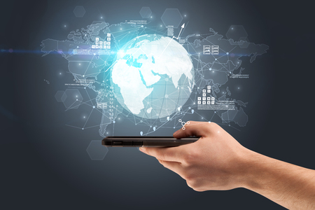 Hand using phone with multinational worldwide estate report concept