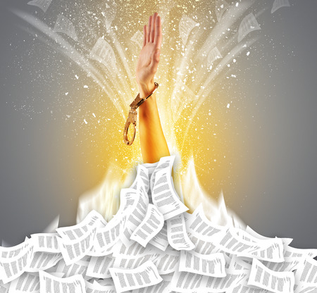 Hand buried in document pile and breaking out from it Stock Photo - 119163915