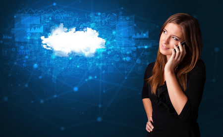 Person talking on the phone with blue cloud technology concept Stock Photo