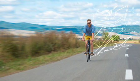 Young cyclist in casual clothing with fabulous nature background Foto de archivo