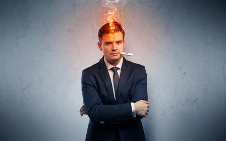 Fever businessman with burning head concept Stock Photo