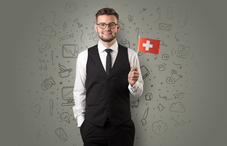 Businessman with office symbol concept and little flag on his hand Фото со стока