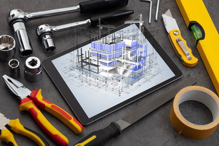 Tablet with construction tools and 3d house plan concept Stok Fotoğraf