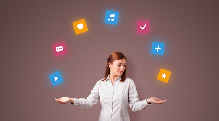 Young person juggle with application icons 写真素材