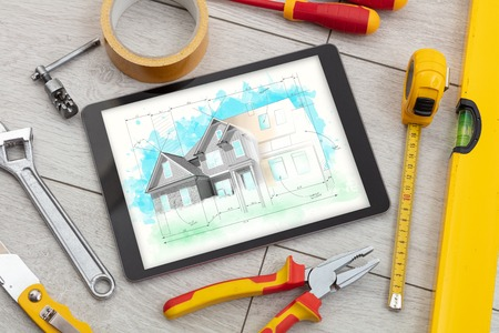 Tablet with construction tools and house plan concept Stock Photo