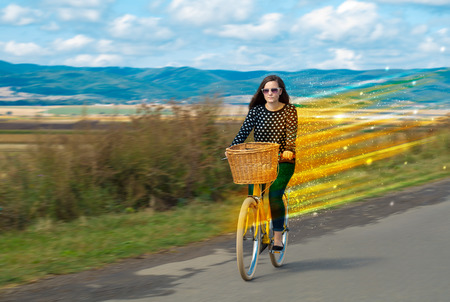 Young riding bicycle in fabulous nature with high speed