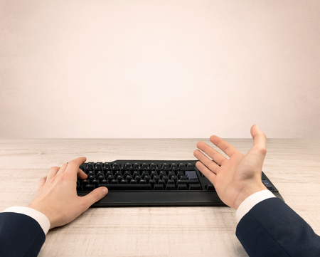 First person view of an elegant businessman hand  typing on light background