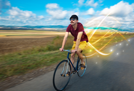 Young cyclist riding bicycle with magical landscape and concept