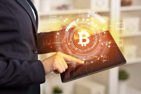 Business woman using tablet in home office mood with cryptocurrency bitcoin link network concept Stok Fotoğraf