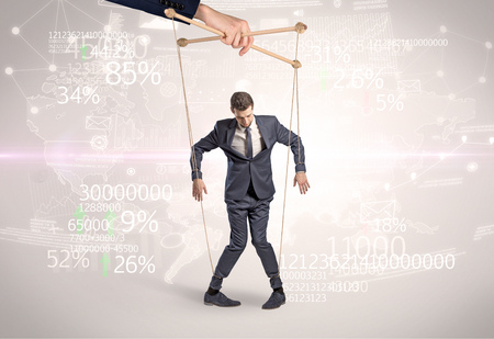 Subordinated puppet man with results numbers and financial concept Archivio Fotografico