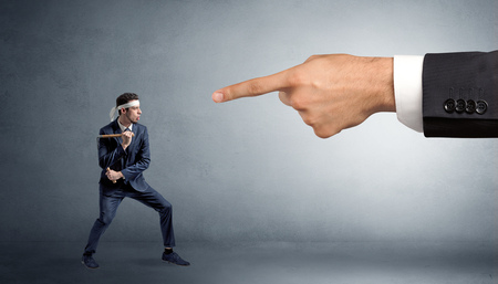 Small karate man fighting with big hand