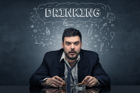 Loser drunk man with drinking, drug, hangover, alcoholic drugs concept Standard-Bild