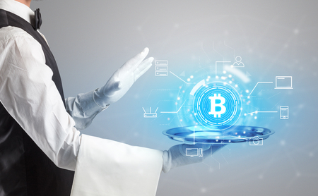Waiter serving on a tray cryptocurrency and mining concept Stock Photo