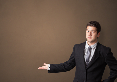 Young person presenting something with empty space