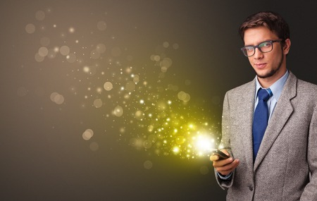 Person using phone with gold sparkling concept