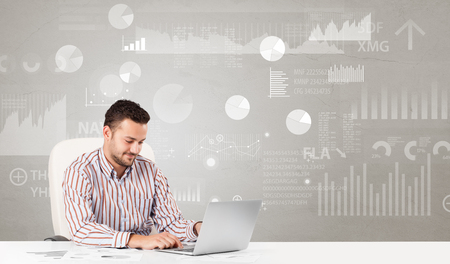 Business person sitting at desk with financial change, and report diagram concept