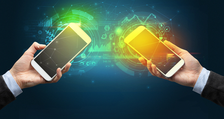 Close up of two smartphones, business and communication concept Imagens