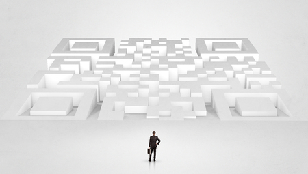 Businessman standing and thinking in top of a huge maze