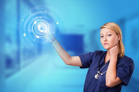 Doctor touching blue screen with call center concept Reklamní fotografie