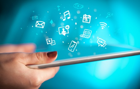 Hand holding tablet with drawn multimedia and application icons Stock Photo
