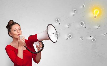 Person talking in megaphone with bulb, new idea concept Imagens