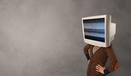 Young person with monitor head with no channel concept 免版税图像