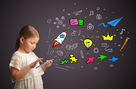 Adorable girl working on tablet with application and gadgets concept Stok Fotoğraf