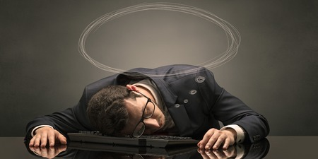 Young businessman sleeping and dreaming at the office Foto de archivo