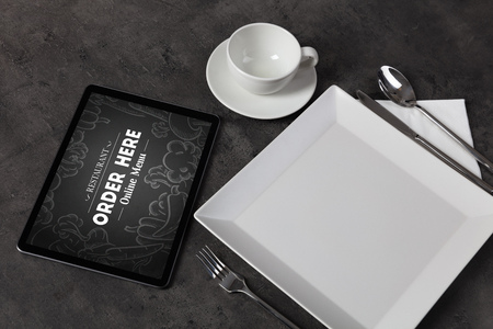 Tablet with online order concept on a lain table Фото со стока
