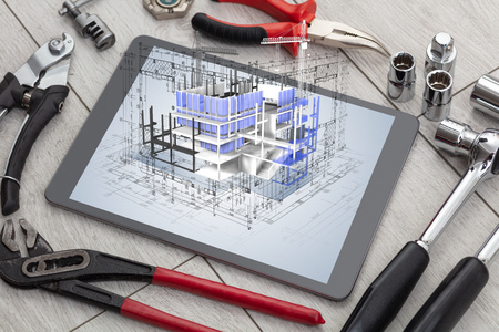 Tablet with construction tools and 3d house plan concept 스톡 콘텐츠