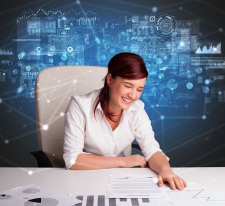 Young manager at the office making report and statistics Stock Photo