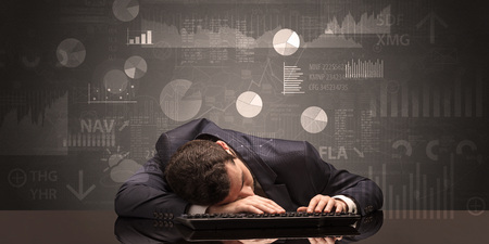 Young businessman sleeping with charts, graphs and reports on the background