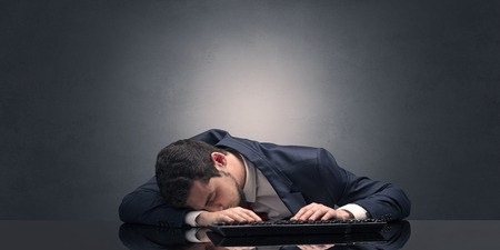 Young businessman fell asleep at his workplace with copy space 版權商用圖片