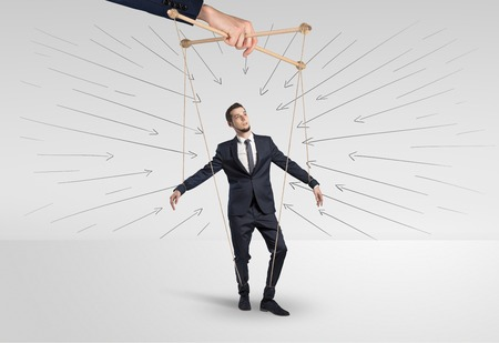 Marionette businessman with doodle lines and arrows around him Stock Photo