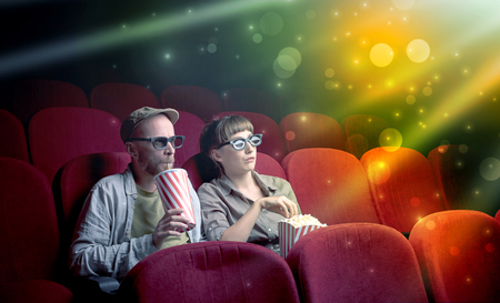 Fanciful couple watching miraculous part of a movie