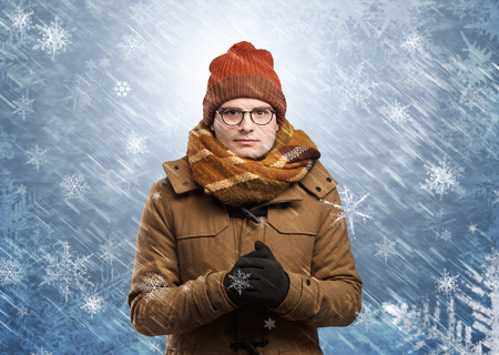 Gorgeous boy wearing warm clothing and freezing in cool snowy  concept Stock Photo