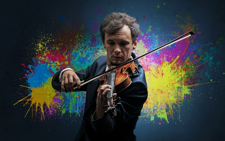 Young classical violinist musician with colorful splotch wallpaper