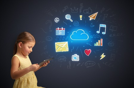 Adorable girl working on tablet with application and gadgets concept 版權商用圖片