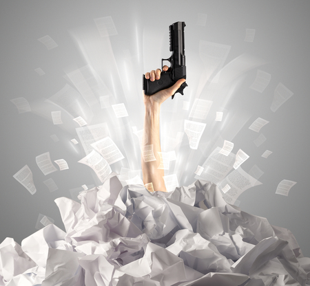 Hand coming out from a huge paper pile Stock Photo - 122299363