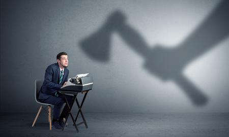 Shadow threatening hard worker man who is afraid Banco de Imagens