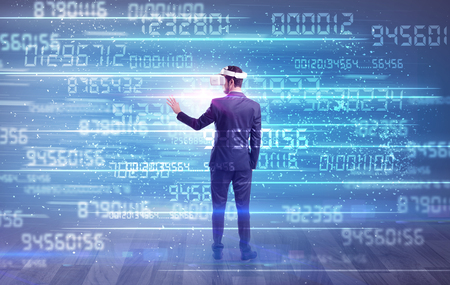 Businessman in vr glasses with variable fast changing numbers around Standard-Bild