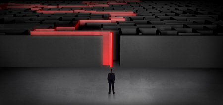Businessman getting ready to enter the dark labyrinth with stated road concept Banco de Imagens