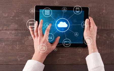 Hand touching tablet with cloud computing and online storage concept Stok Fotoğraf