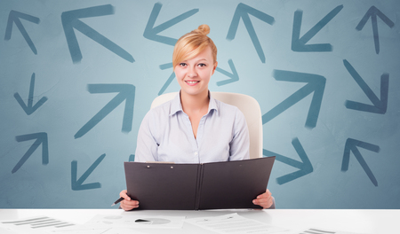Business person sitting at desk with different direction concept Stockfoto